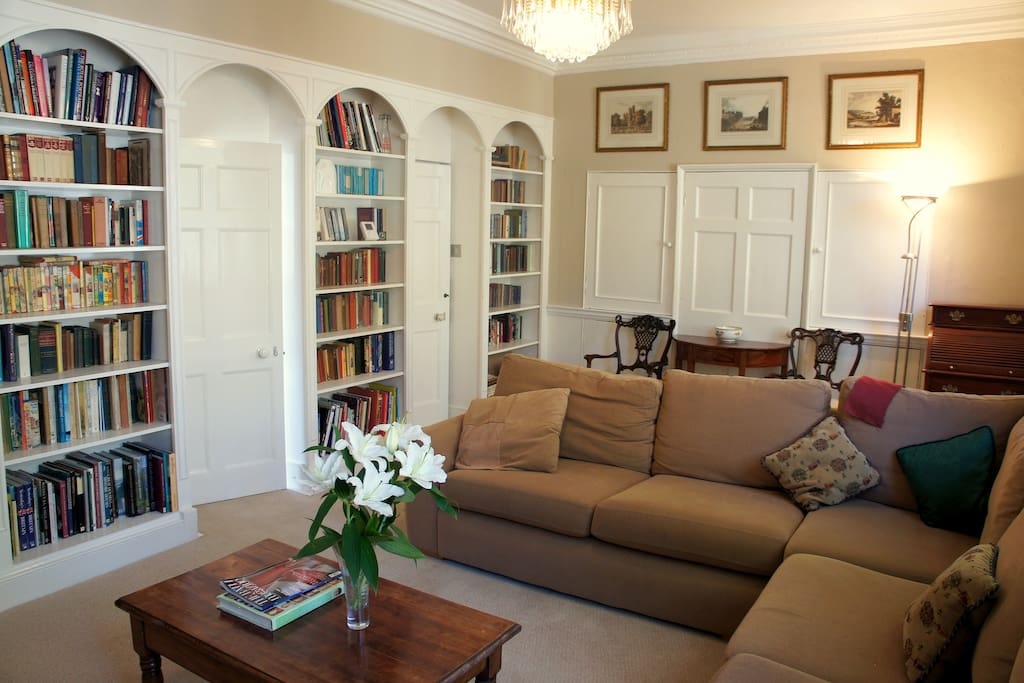 """Large living room with library and 40"""" tv."""
