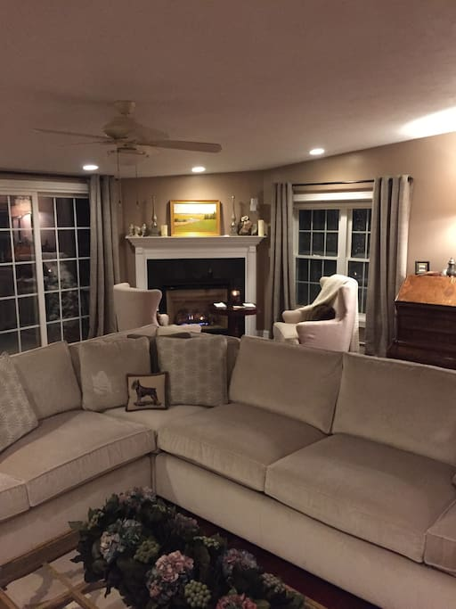 Luxurious living room with fireplace. Bonus large family room with Smart TV and surround sound.