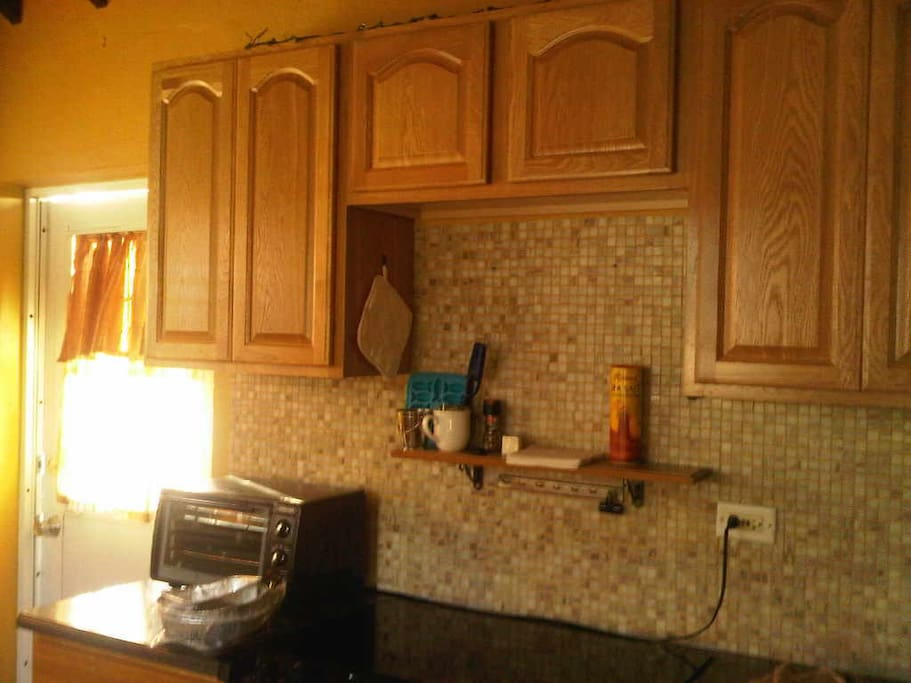 Cabinets above counter top stove and microwave in