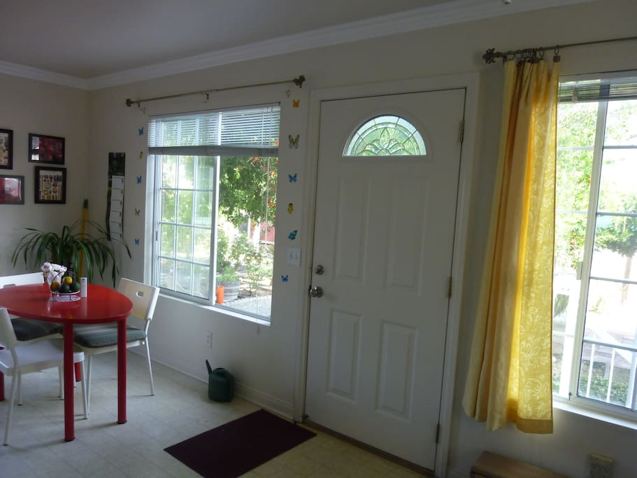 Two big windows with Garden Views,  From here you can watch the local birds hang out in the Bird Bath & Trees