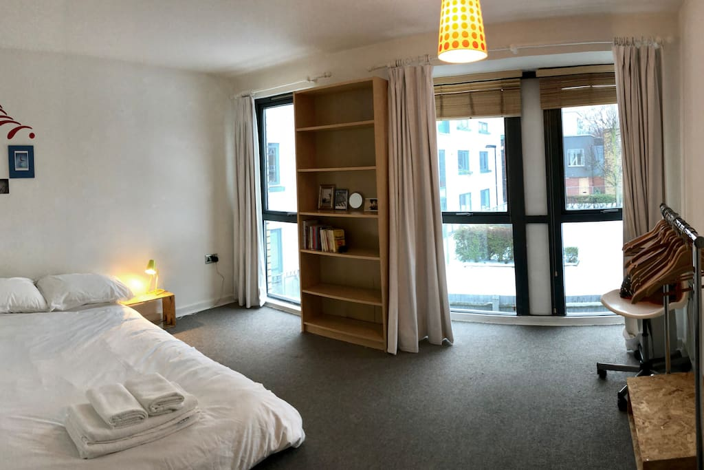 A quiet double bedroom with three floor to ceiling windows for plenty of light.