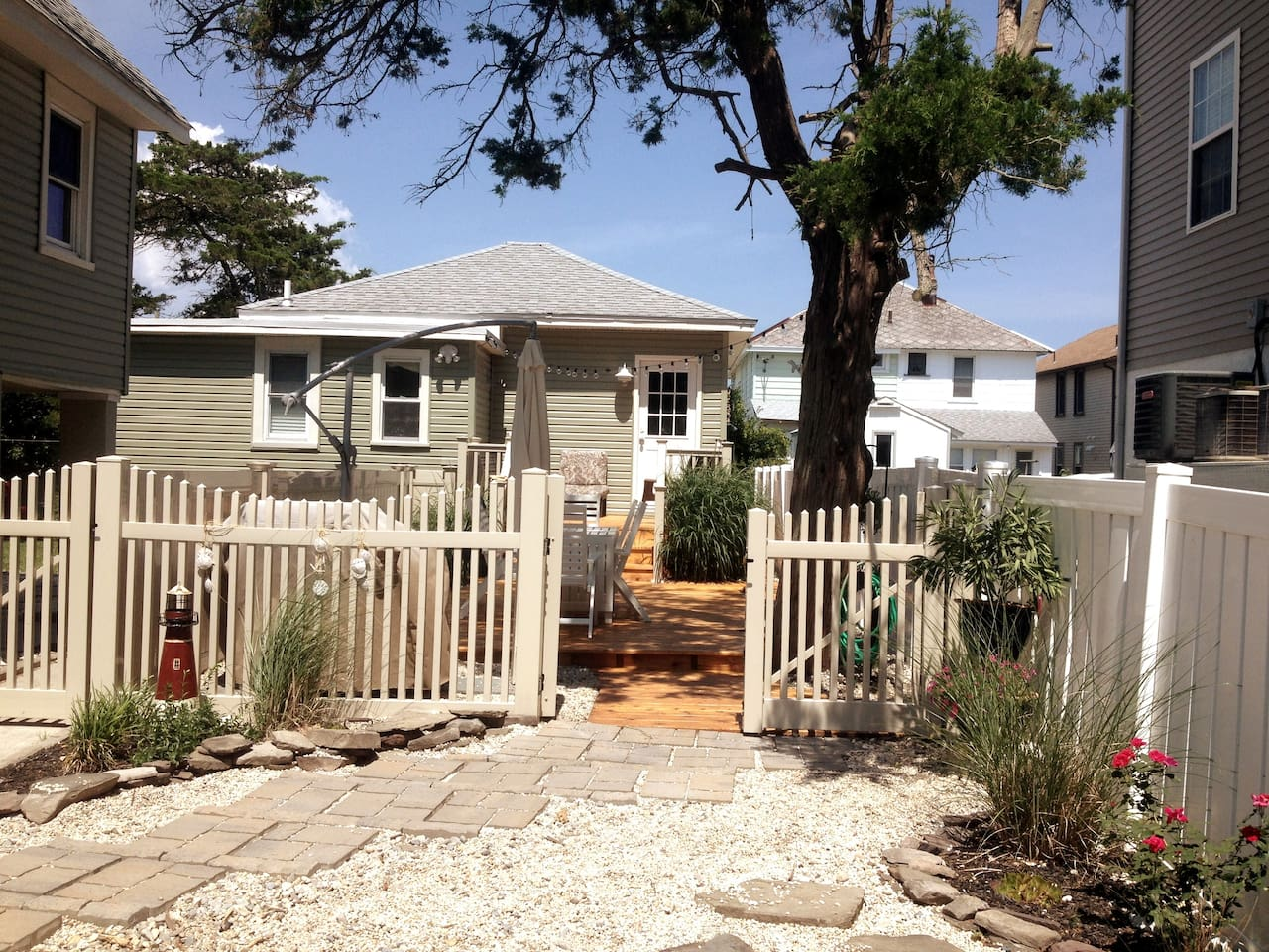 Spacious and private front deck with comfy rocking chairs, dining set, gas grill and outdoor shower.