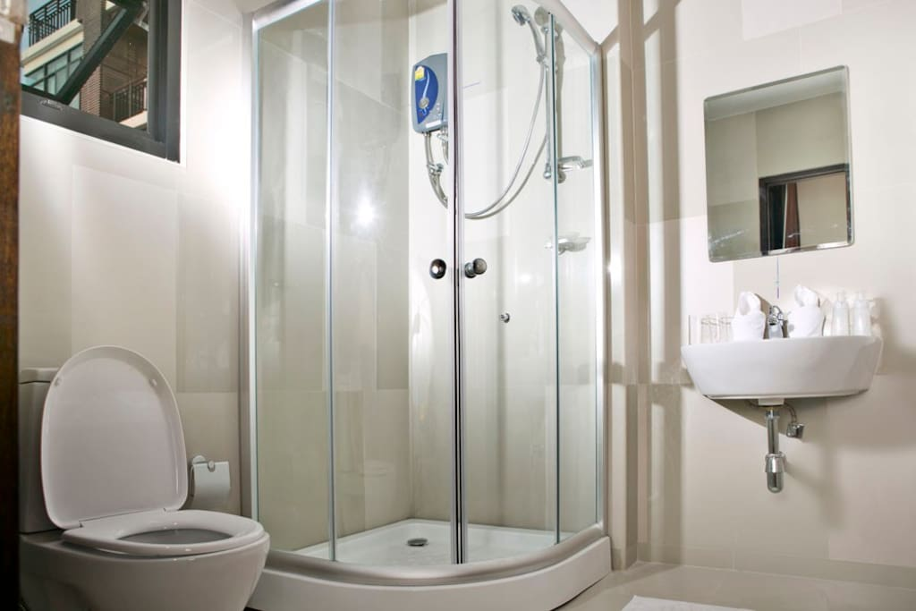 Attached spacious bathroom with hot shower.
