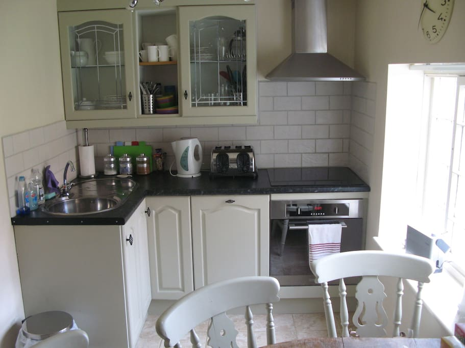 Separate kitchen/diner with cooker, large fridge freezer, microwave, and oven/hob
