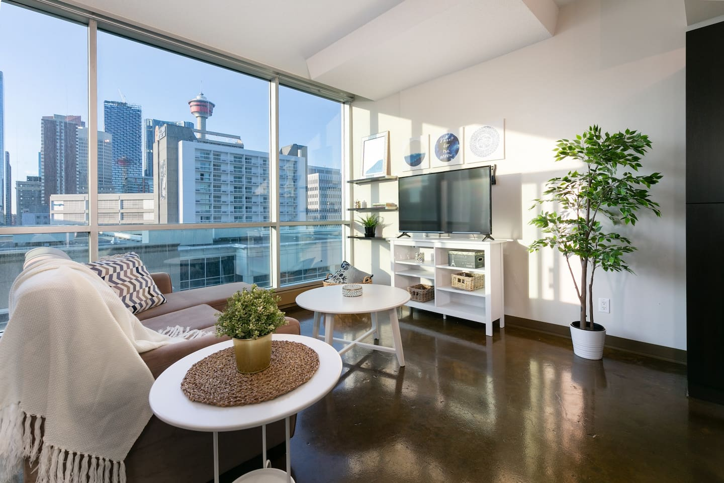 Luxurious and cozy living area with sweeping downtown views
