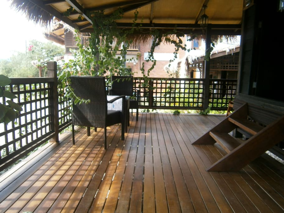 Large veranda to sit upon and take in the views in front of the rice fields and mountains as well as the sunset.