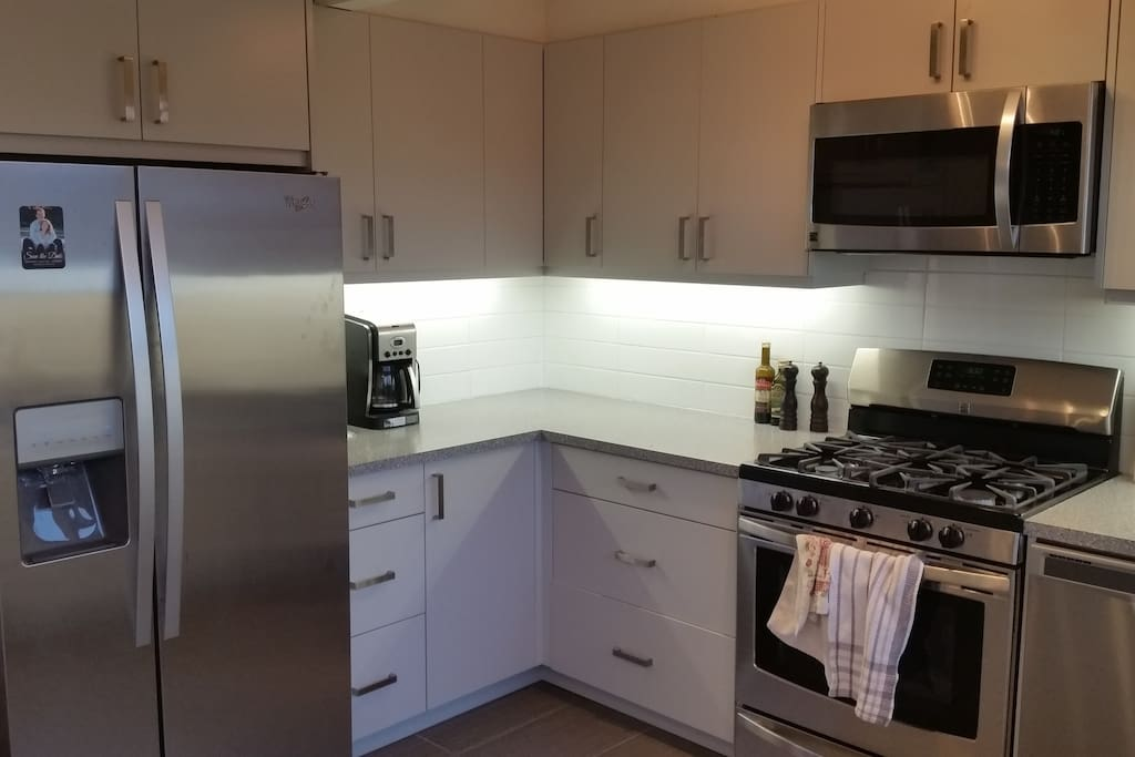 Brand new custom Kitchen including gas range
