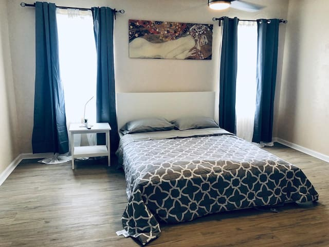 Master bedroom - Queen bed for two, dresser, iron, iron board