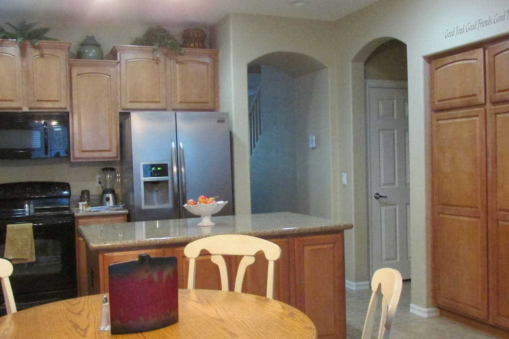 Sitting area and 1/2 bathroom to the right of this fully equipped kitchen