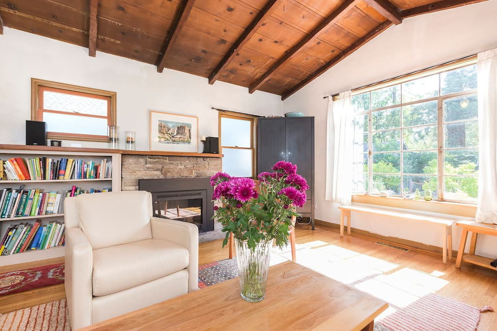 Comfortable living room with gas fireplace overlooking the peaceful garden. Light filled most of the day.