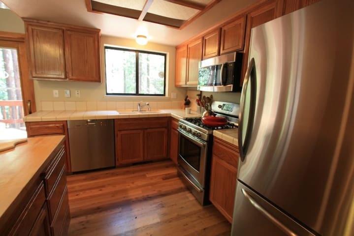 Chef's kitchen:  Butcherblock island, Miele Dishwasher, Gas Range with Convection Oven, Top Fridge/Bottom Freezer, Microwave and more