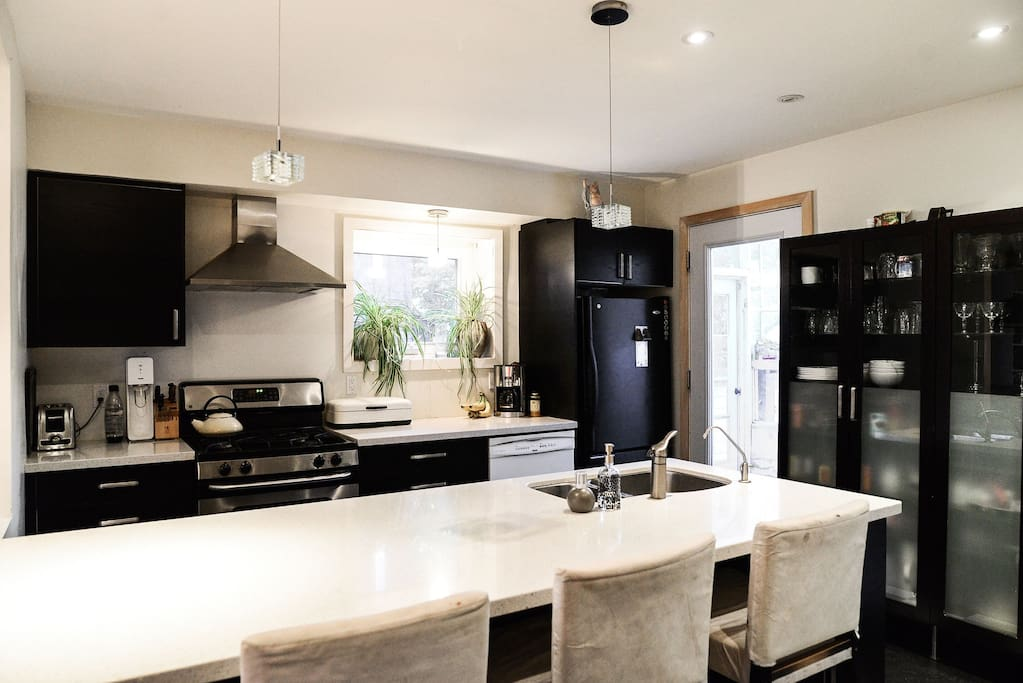 Open concept kitchen with everything you need to for a great meal (including takeout menus)