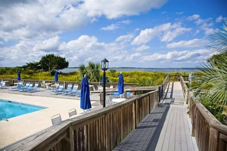 Condominium pool and boardwalk to beach
