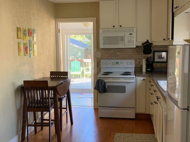 The open floor plan includes a kitchen with dishwasher and shelves stocked with everything you need to support big or small meals.