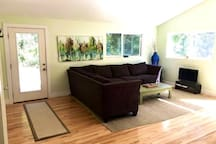Living Room area with sectional and smart TV