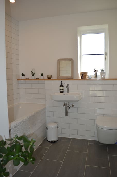 Shared Bathroom with shower and bath