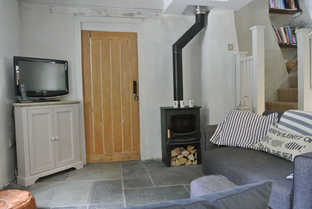 Open plan living room with comfy sofas and log burner