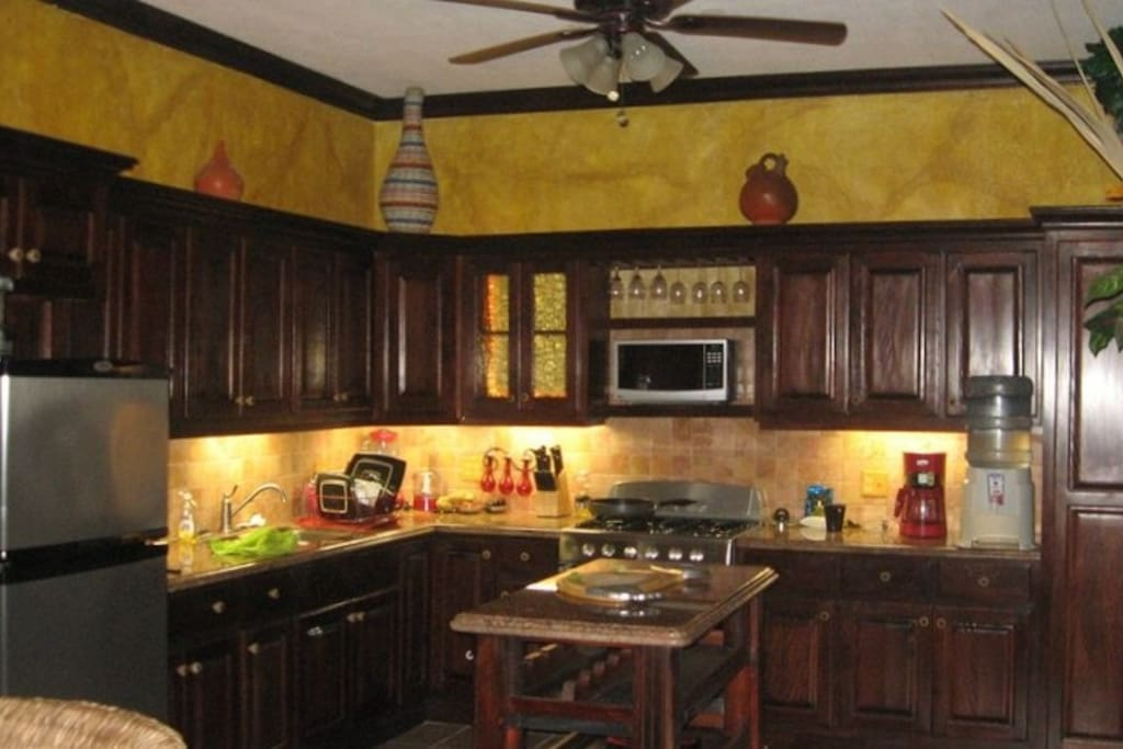 Luxury kitchen, under cabinet lighting, all granite counters, quality appliances!