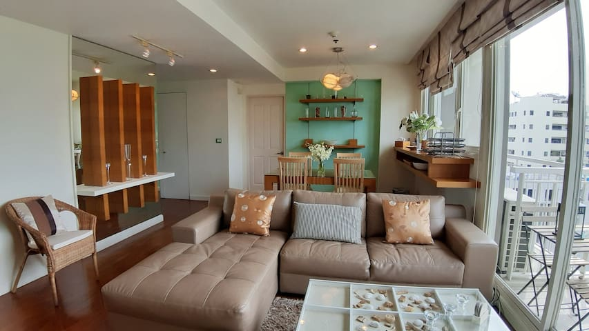Spacious living room of 32 m2 with leather sofa and teck floor. Amazing view from every room