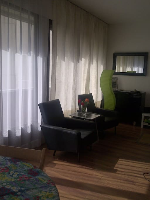 Bedroom: drawer, mirror, 2 armchairs, coffee table, lamp