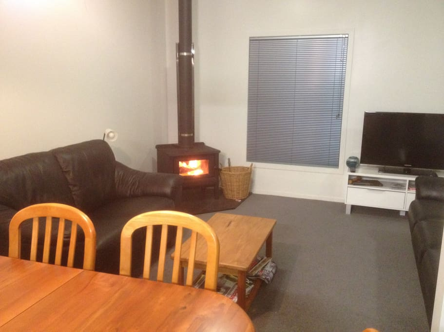 Lounge/dining with modern wood burner.