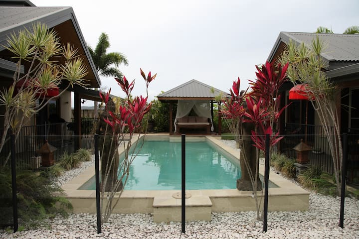 The pool area with daybed in the pool gazebo
