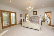 Bedroom view with attached screened in  porch. King bed and private bathroom