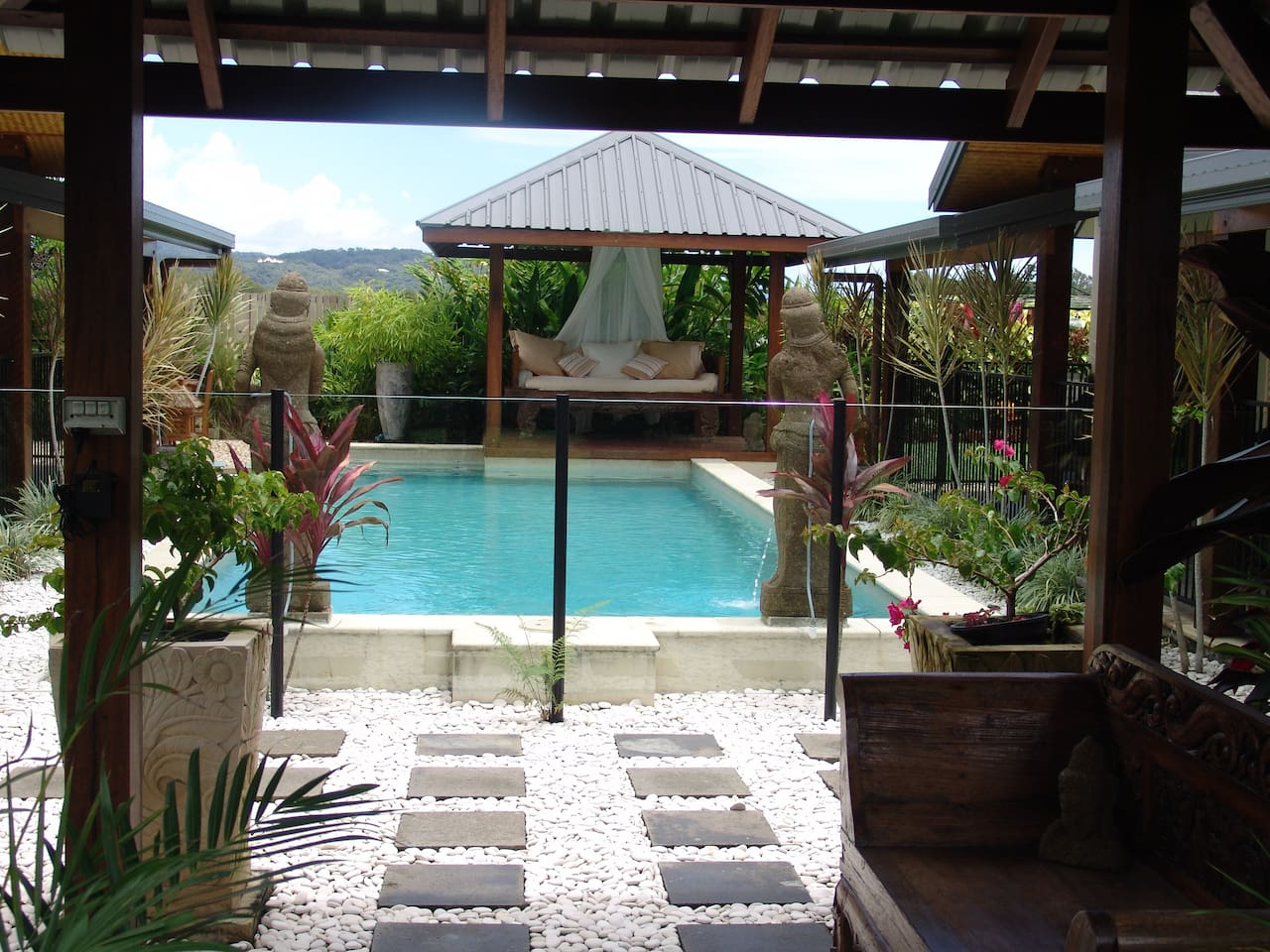 The pool through the front entrance gazebo