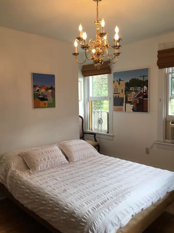 A beautiful  bedroom for you with a fabulously comfortable tempurpedic mattress. Original paintings by Nancy at Nancy's Yellow House.