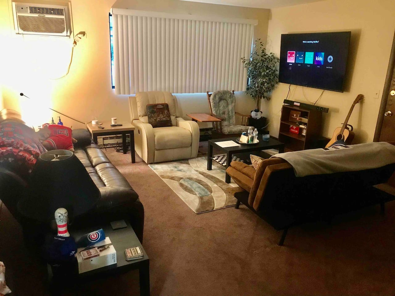 Living room view with 2 side table lamps, welcome tray filled with snacks and beverages, and a total of 6 seating areas with 3 reclining seats!