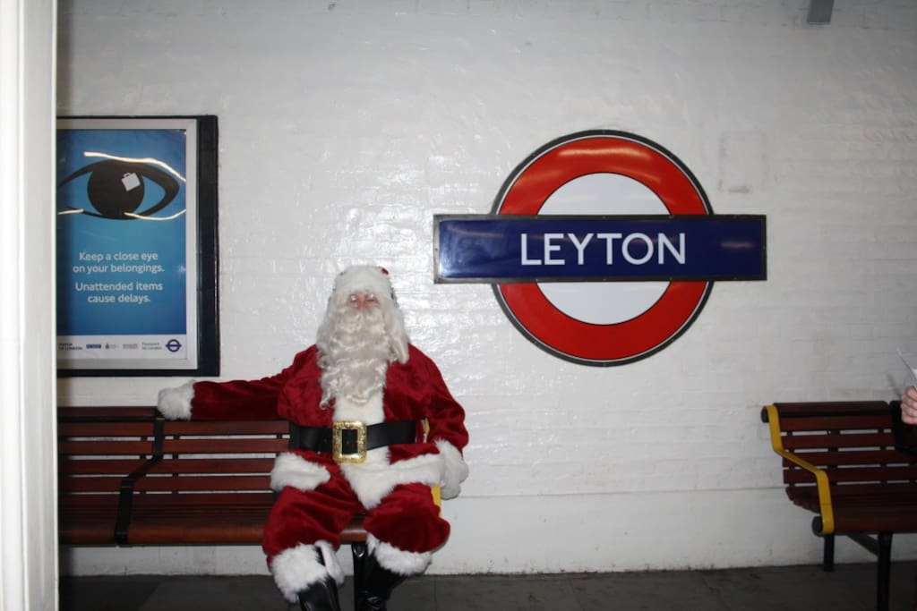 Santa Claus waiting for his reindeer's on the platform at Leyton.