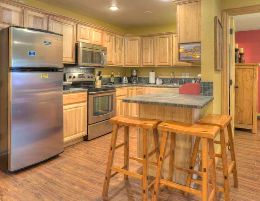 Fully equipped kitchen w/ stainless steel appliances
