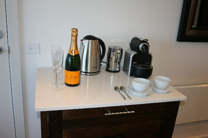 Buffet with Nespresso coffee machine, kettle, toaster & mini-bar fridge (sorry, champagne not included!)