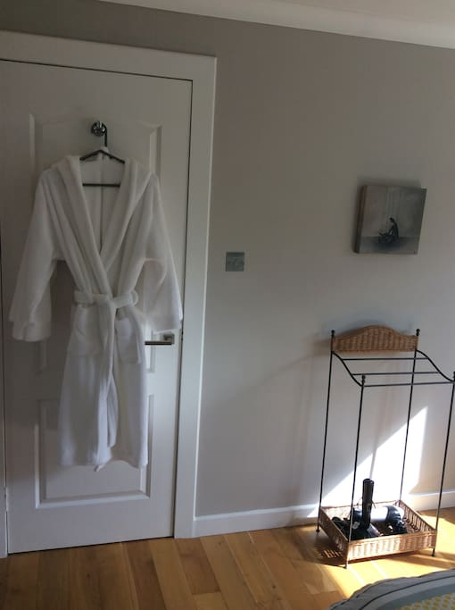 Fluffy bath robes, hairdryer and hair straightners
