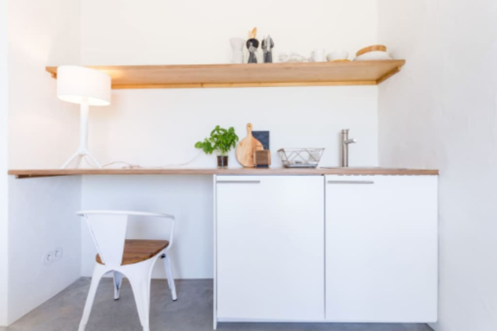A view of the kitchenette which comes complete with all your basic needs like a fridge, a portable induction hob for your cooking, plates, pans and all the other standard basics.