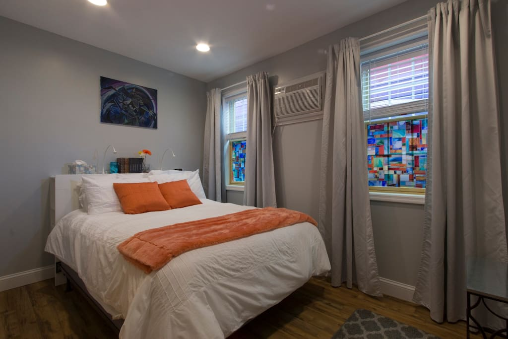 Cheery bedroom with pillow-top Queen comfy duvet and pillows.
