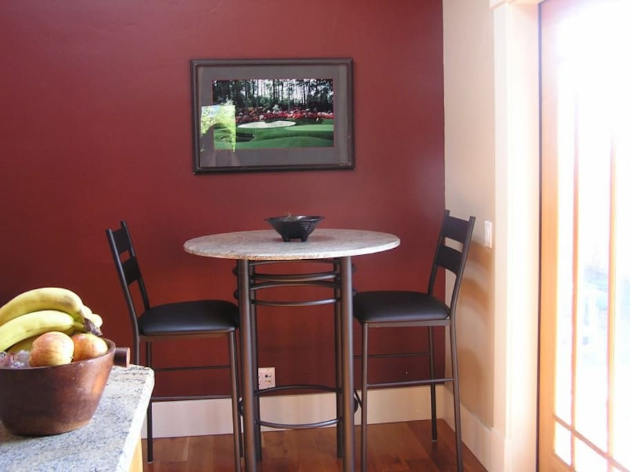Pub Style table.  Two more chairs stored in Garage.  Double outswing French doors open to patio.