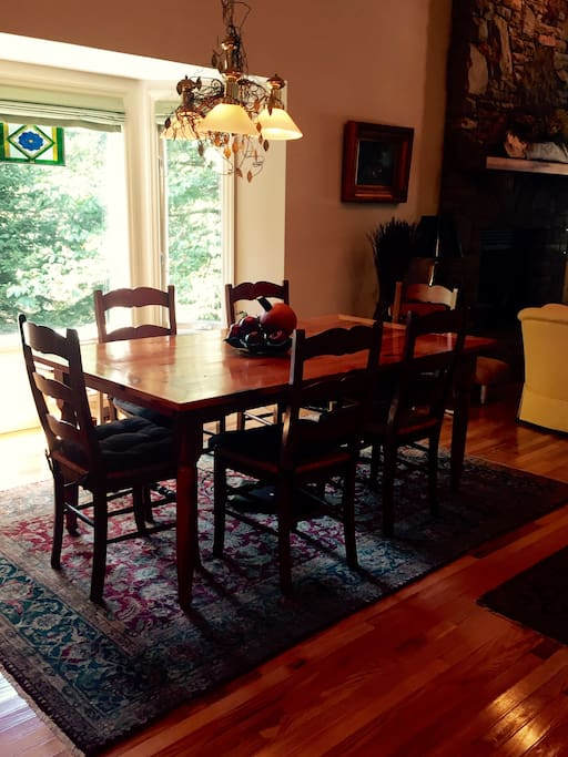 Dining area next to bay window .  Home is beautifull furnished  and maintained!