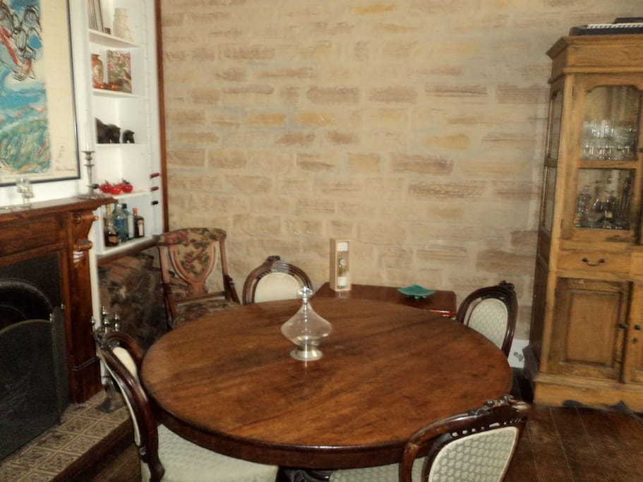The formal dining room with open fire for winter and thick, exposed  sandstone walls to keep you cool in summer