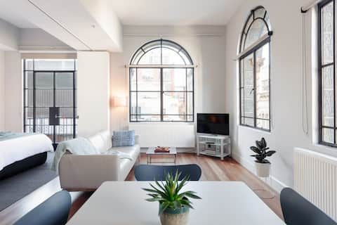 Look out over the CBD from a Boutique Flat