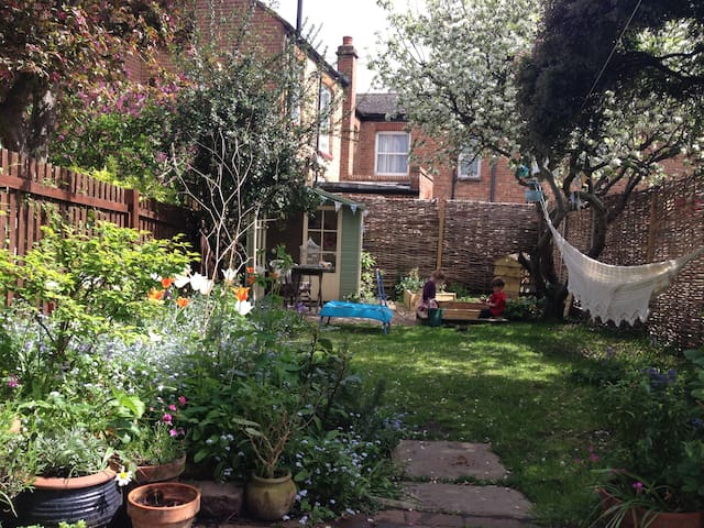 The garden in summer complete with hammock and summer house - and sandpit for the kids!