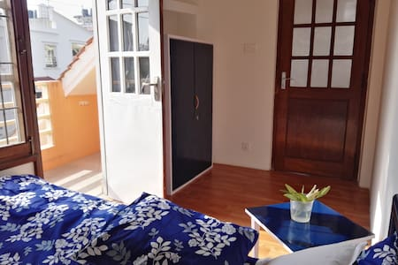 Bright and cozy room with private balcony in Patan