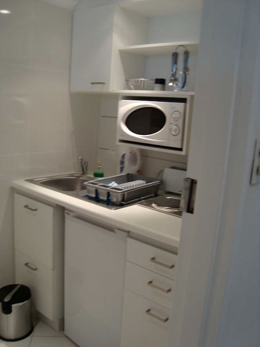 Fridge, 2 plate hob,( ( no oven.) very well equipped= crockery cutlery,  kettle, toaster, microwave, sandwich maker pots pans & other.
