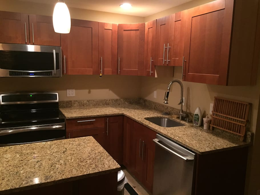 Stainless steel appliances (Microwave, glass stovetop, dishwasher, and coffee maker). High end cabinets and granite countertops.