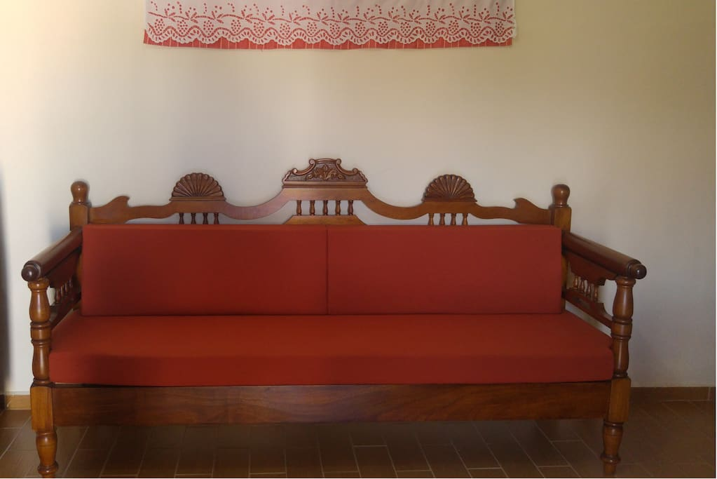 Traditional sofa and art craft on the wall.