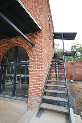 entrance to the space. the staircase was made on site