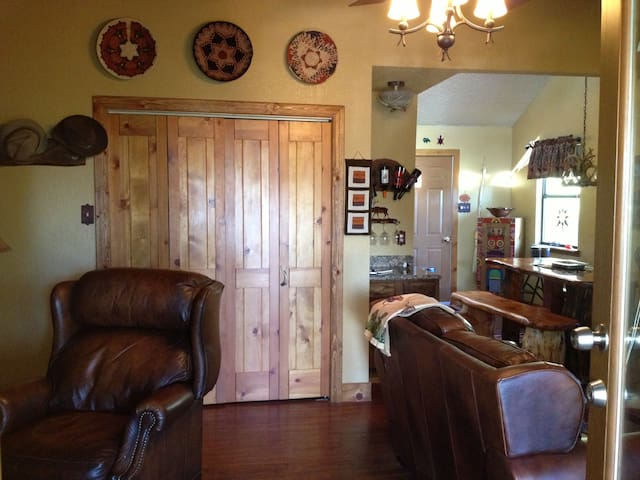 upon entering the front door..living area to the right and tv with recliners to the left