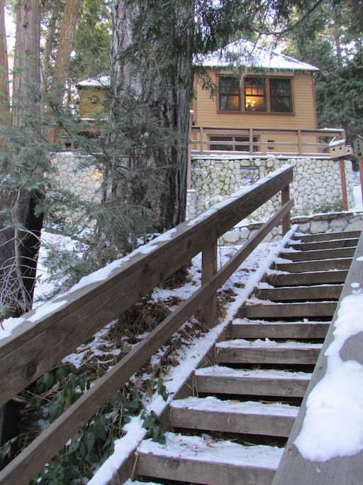 A short drive past the Lake Arrowhead Village entrance is a parking area for two cars in front of the Bunkhouse.  Front view showing stairs leading from the parking area to the front door