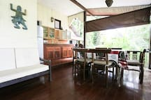 Terrace with open basic kitchen, dining area, sofa and seaview...