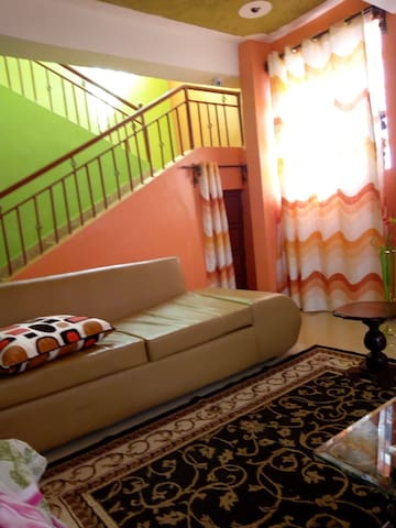 Stairs to the upper rooms and upper balcony and fire place
